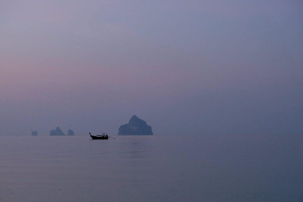boat in the sea before sunrise kokradan andaman sea